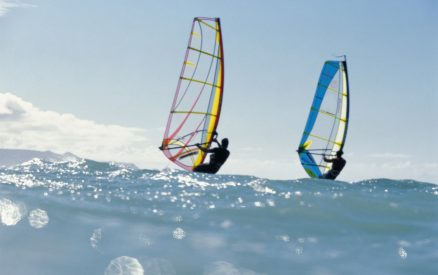 Two men enjoying Maui windsurfing in Paia
