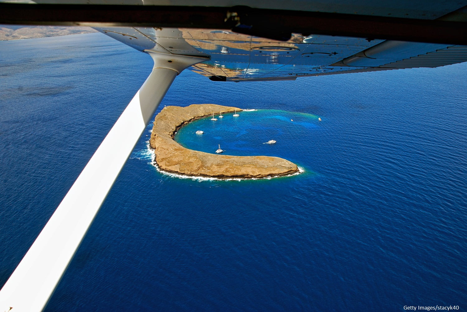 Aerial View of Molokini Crater from Maui airplane tours