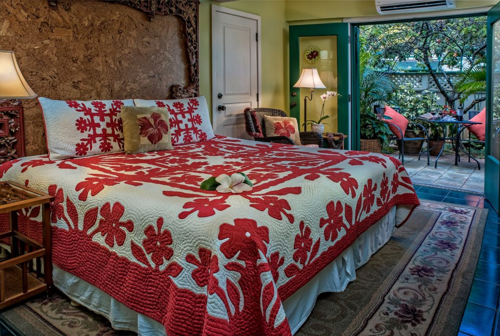 View of the bed in the Hibiscus Garden Room